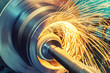 canvas print picture - Internal grinding of a cylindrical part with an abrasive wheel on a machine, sparks fly in different directions. Metal machining.