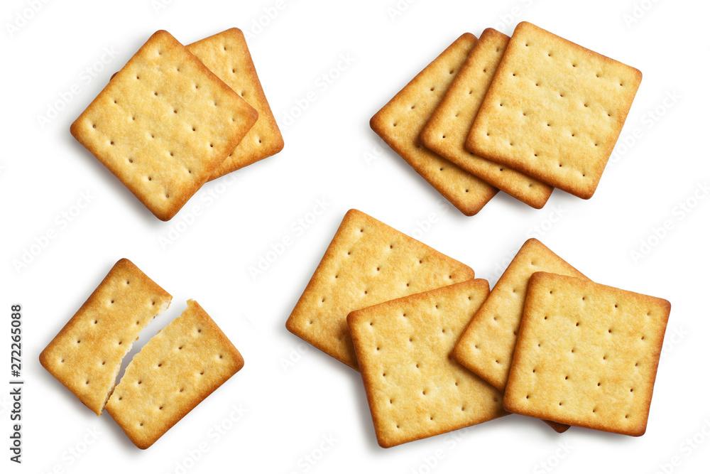 Fototapeta Set of delicious square crackers, isolated on white background