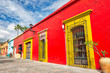 Leinwanddruck Bild - Oaxaca, Mexico-1 December, 2018: Scenic old city streets and colorful colonial buildings in historic city center