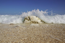 Ocean Wave Crashing Against The Rocks