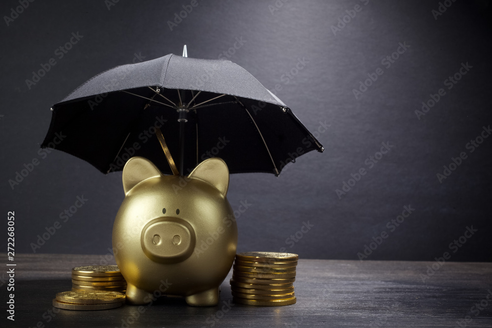 Fototapeta Gold Piggy bank with umbrella concept for finance insurance, protection, safe investment or banking