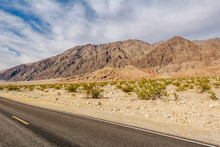 Road Through A Desert And Moun...