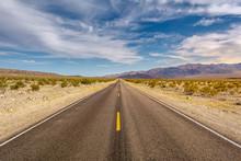 Road Through A Desert And Moun...