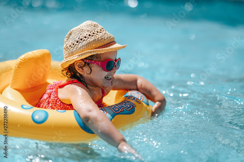 plakat Child In Swimming Pool with ring. Summer Vacation With Kids.