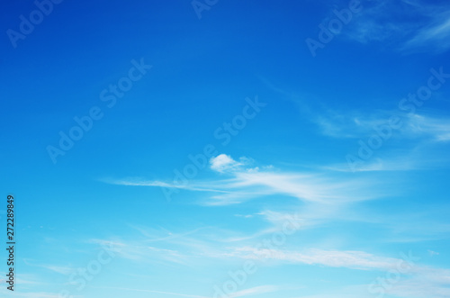 Blue sky with clouds background - 272289849