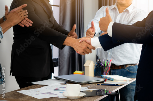 Fototapety, obrazy: Group of businessman meeting and shaking hand after  successful negotiating.