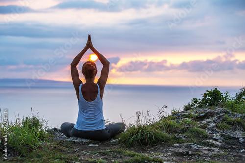 Caucasian woman practicing yoga at seashore Canvas Print