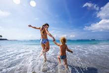 A Family Is Having Fun At The Seashore