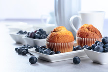 Muffins And Blueberry On White Table.