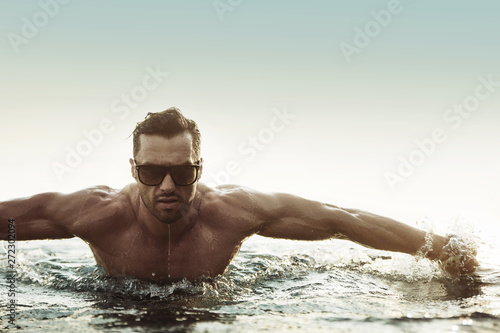Tuinposter Artist KB Portrait of a serious man in a tropical pool