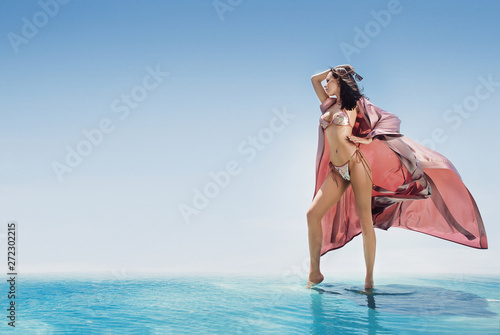 Fotobehang Artist KB Sensual young lady relaxing by the tropical pool