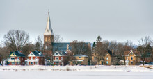 Church And Street Scene Of Houses In Winter