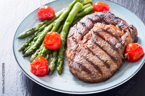 Fototapety, obrazy: Grilled beef steak ribeye with cherry tomatoes and asparagus