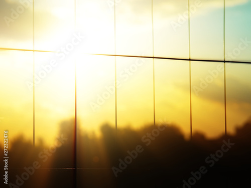 Cadres-photo bureau Gris traffic Rabitz fence at sunset time bokeh background