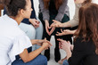 Leinwandbild Motiv Group of young women talking sitting in a circle. Psychological support concept