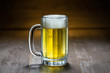 canvas print picture - Classic cold refreshing bright lager pilsner beer in stein mug, on old wooden pub bar surface
