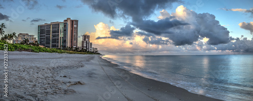 High rise buildings in the distance on North Naples Beach at sunrise Wallpaper Mural