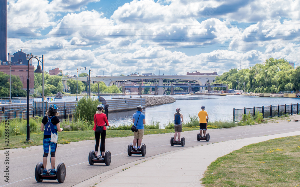 Fototapety, obrazy: People are riding Segway along Mississippi River