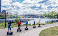 People Are Riding Segway Along...