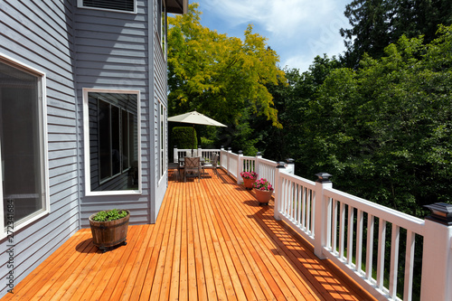 Fototapeta  Brand new red cedar outdoor wooden patio during nice day