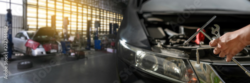 Fotografía  Repair service car Auto mechanic working in garage car mechanic with wrench in g