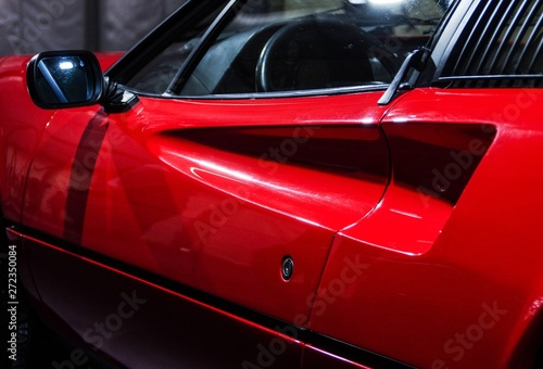 Photo Red vintage sports car door detail