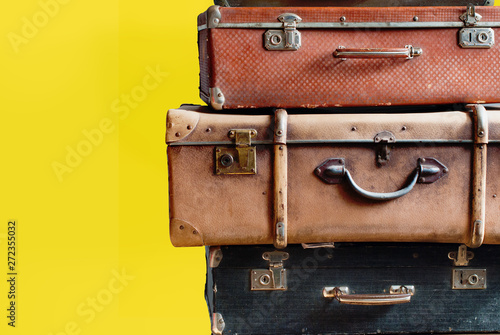 Staande foto Retro Vintage tower ancient suitcases in travel concept