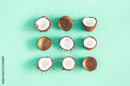 Summer composition. Coconut pattern on mint background. Summer concept. Flat lay, top view