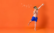Shirtless Man Wearing Snorkel Mask Doing Swimming Gesture