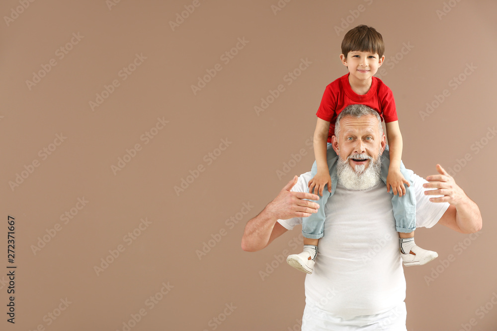 Fototapety, obrazy: Funny little boy with grandfather on color background