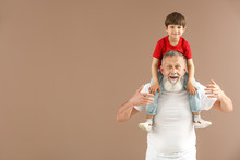 Funny Little Boy With Grandfat...