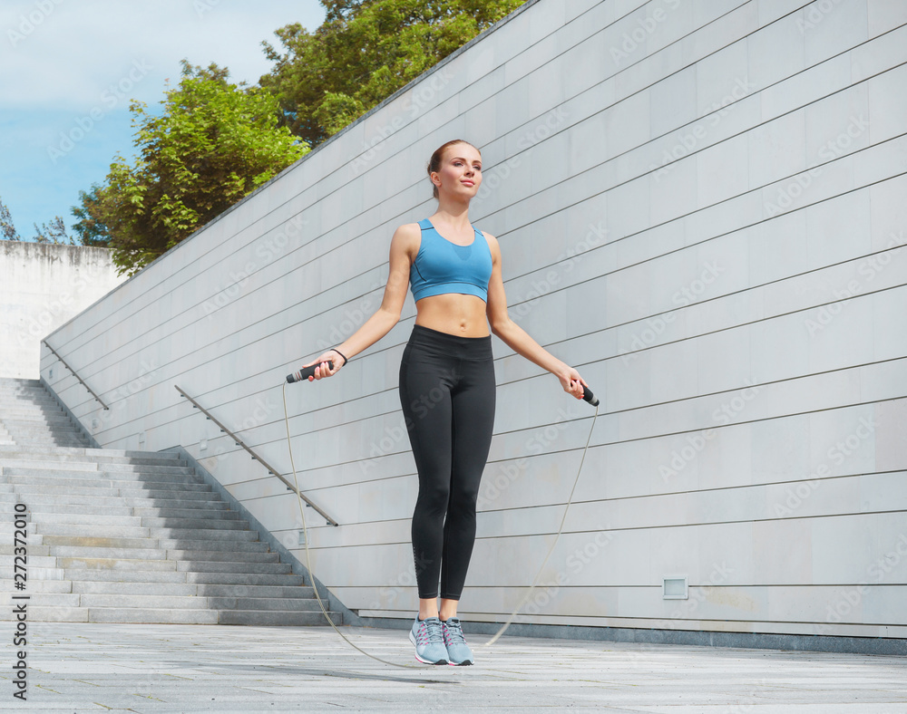 Fototapety, obrazy: Young, fit and sporty brunette girl in sportswear. Woman doing sports outdoor.