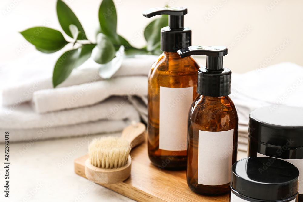 Fototapeta Set of cosmetics for personal hygiene on table