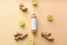 Bottle Of Shampoo, Ginger And Lime On Color Background