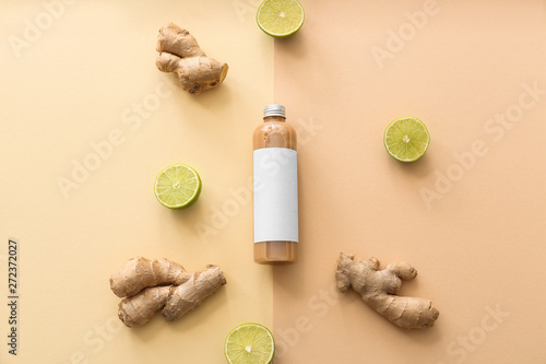 Obraz na płótnie Bottle of shampoo, ginger and lime on color background