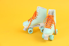 Vintage Roller Skates On Color Background