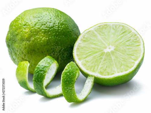Ripe lime fruits on the white background. - 272373039