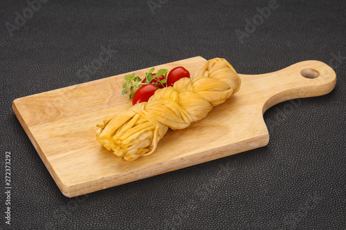 obraz dibond Caucasian traditional pigtail cheese served tomatoes