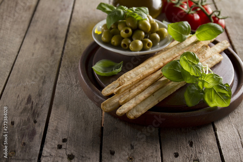 Close-up of wooden tray with tasty aperitives Fototapeta