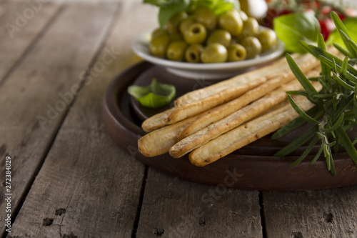 Tablou Canvas Wooden tray with crusty bread and other aperitives