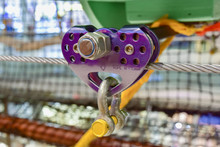 Purple Roller For The Movement Of Equipment On The Steel Cable. Close Up Obstacle Course Element