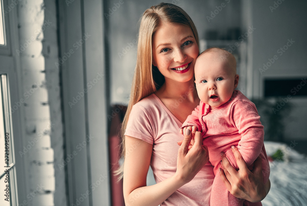 Fototapety, obrazy: Mother with baby girl