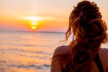 Woman At Sunset. Girl At Sunse...