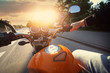 Drive a motorcycle on a sunny day