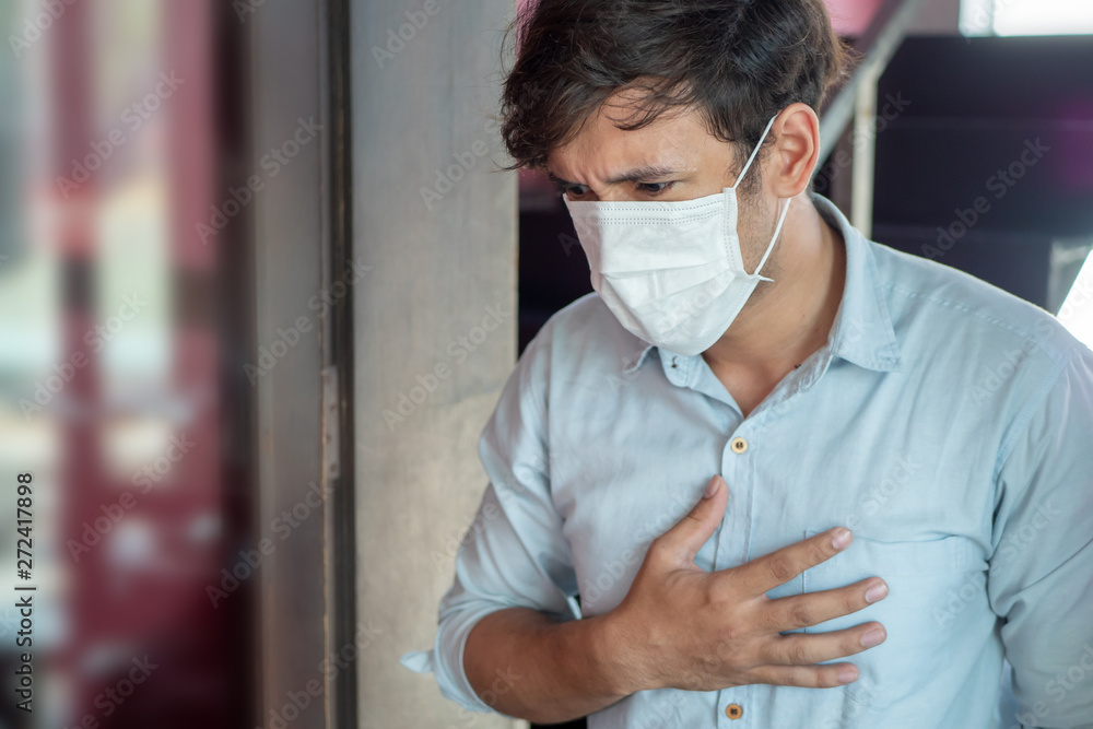 Fototapeta man wearing air filter mask having Dyspnea, breathing difficulty, respiratory distress in unhealthy, danger, polluted air environment