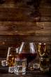 Assortment various hard and strong alcoholic drinks in different glasses: vodka, cognac, tequila, brandy and whiskey, grappa, liqueur, vermouth, tincture, rum, etc. Wooden background copy space