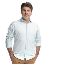 Casual Confident Man Holding Both Hands In His Pockets