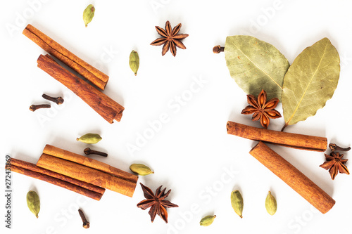 Obraz Healthy food concept Mix of organic spices star anise, cinnamon, bay and cardamom pods on white background - fototapety do salonu