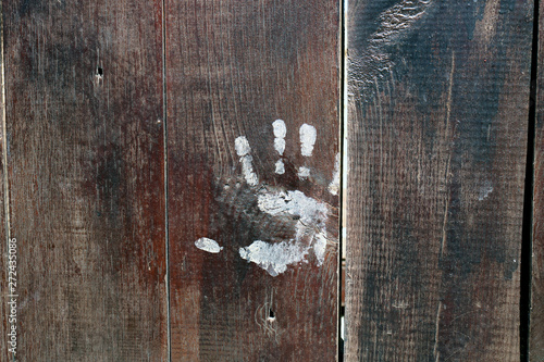 Valokuva  Old wooden door with a small child's handprint