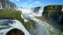 Iguazu Falls And Rainbow On Th...